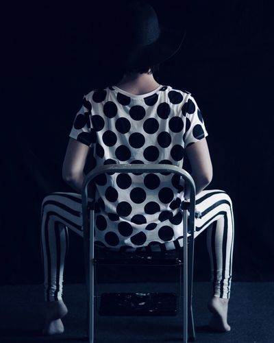Rear View One Person Sitting Fashion Women Black Color Studio Shot Human Back Real People Lifestyles Human Body Part Beautiful Woman One Woman Only Young Women Young Adult Indoors  Black Background Back Adult The Fashion Photographer - 2018 EyeEm Awards