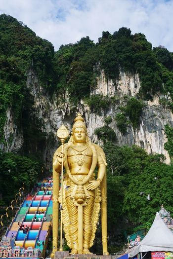 Statue of temple against mountain