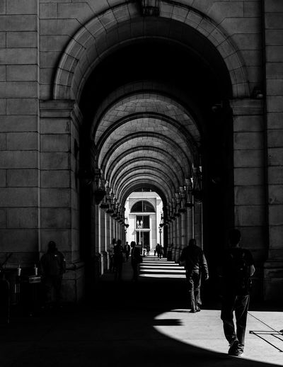 People walking through corridor
