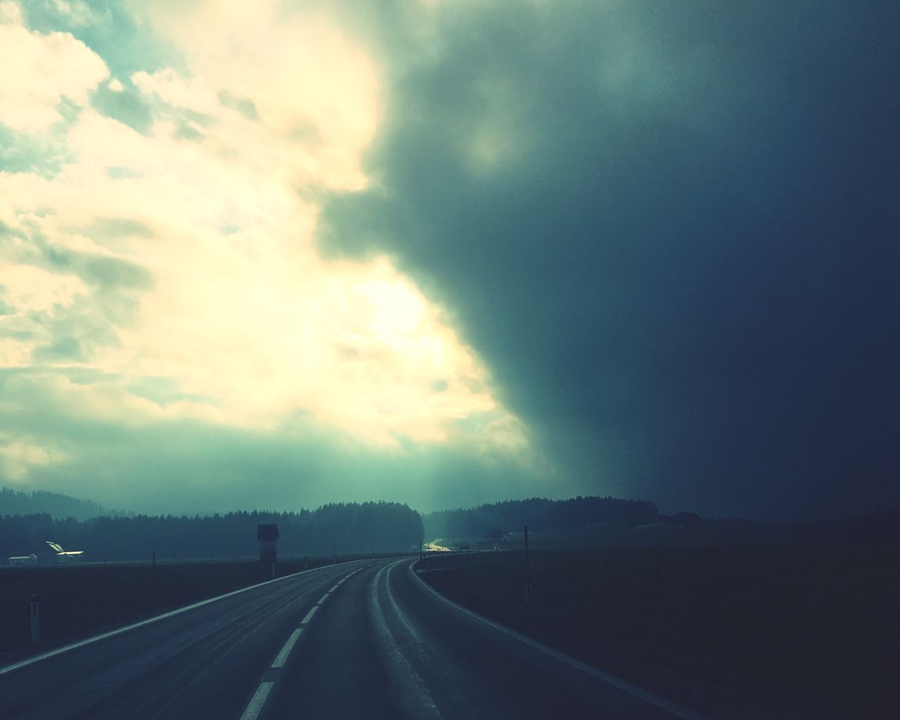 transportation, road, cloud - sky, sky, the way forward, direction, no people, symbol, diminishing perspective, nature, sign, marking, highway, road marking, beauty in nature, car, non-urban scene, vanishing point, tranquility, outdoors, dividing line