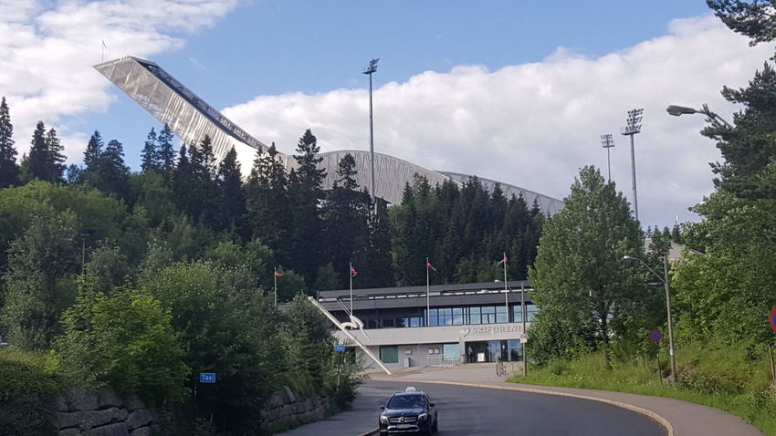 Holmenkollbakken is a large ski jumping hill located at Holmenkollen in Oslo, Norway. It has a hill size of HS134, a construction point of K-120, and a capacity for 70,000 spectators. Holmenkollen has hosted the Holmenkollen Ski Festival since 1892, which since 1980 have been part of the FIS Ski Jumping World Cup and 1983 the FIS Nordic Combined World Cup. It has also hosted the 1952 Winter Olympics and the FIS Nordic World Ski Championships in 1930, 1966, 1982 and 2011. The hill has been rebuilt 19 times; important upgrades include a stone take-off in 1910, an in-run superstructure in 1914, and a new superstructure in 1928. During the Second World War, the venue was used as a military installation, but upgraded in the late 1940s. Further expansions were made ahead of the 1966 and 1982 World Championships, as well as in 1991. Between 2008 and 2010, the entire structure was demolished and rebuilt. As of 8 February 2011, the hill record is unofficially held by Anders Jacobsen at 142.5 meters. The official hill record was set at 5 March 2011 by Andreas Kofler at 141 meters. The hill is part of Holmenkollen National Arena, which in addition to cross-country and biathlon venues has the normal hill Midtstubakken. Adrenaline Adrenaline Junkie Getting Inspired High Hill Holmenkollbakken Holmenkollen Olympic Olympicgames Olympics Ski Ski Jump Ski Jumping Ski Jumping Hill Ski Jumps Skiing Skijump Skijumping Speed Sport Sports Sports Photography Superstructure The Purist (no Edit, No Filter) Winter Olympics