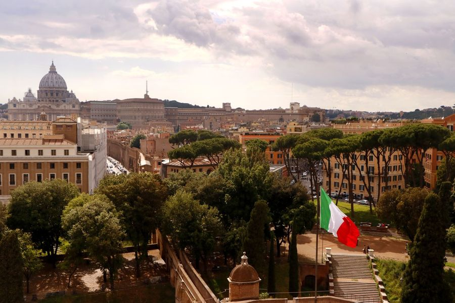 The skyline of Rome Italy as viewed from the top of Castel Sant' Angelo with Vatican city in the distance Travel Photography Architecture Building Building Exterior Built Structure City Cityscape Cloud - Sky Day Europe History Landscape Nature Outdoors Place Of Worship Religion Sky The Past Tourist Destination Travel Travel Destination Travel Destinations Tree Vatican City Viewpoint