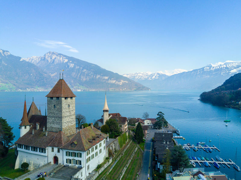 Architecture Building Exterior Built Structure Castle City Cityscape Day Mountain Mountain Range Nature No People Outdoors Place Of Worship Scenics Sea Sky Spiez Switzerland Travel Destinations Water