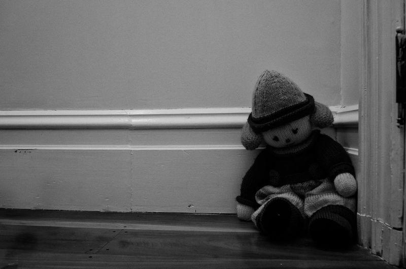Boy looking away while sitting on floor