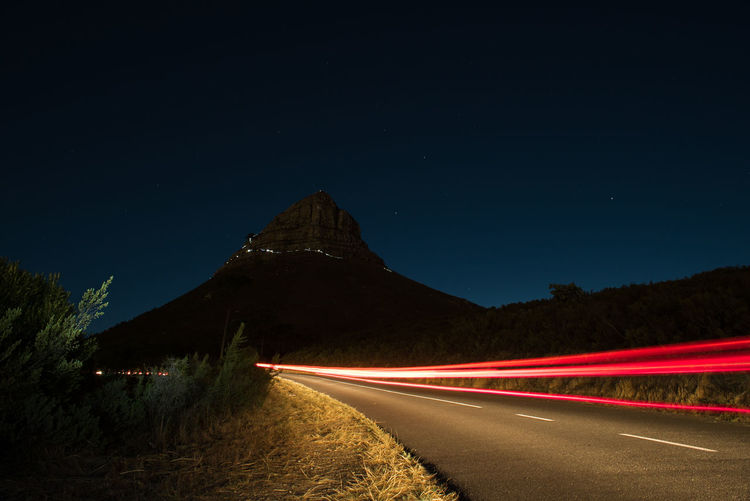 Lions Head Beauty In Nature Car Trails Clear Sky Illuminated Light Trail Long Exposure Motion Mountain Nature Night No People Outdoors Road Scenics Sky Speed Star - Space Transportation