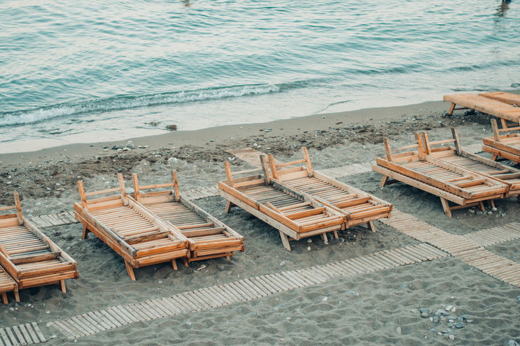 High angle view of chairs at beach