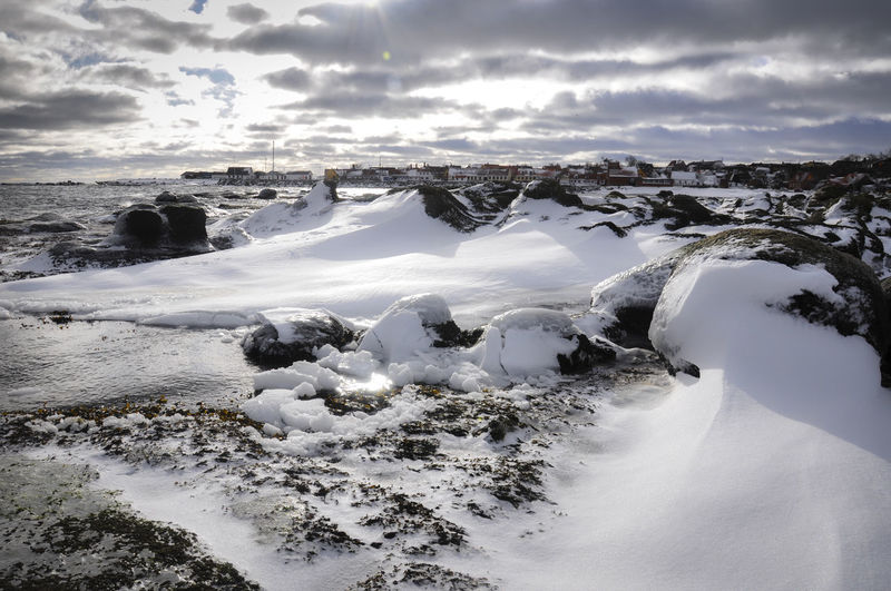 Scenic View Of Frozen Beach Against Sky
