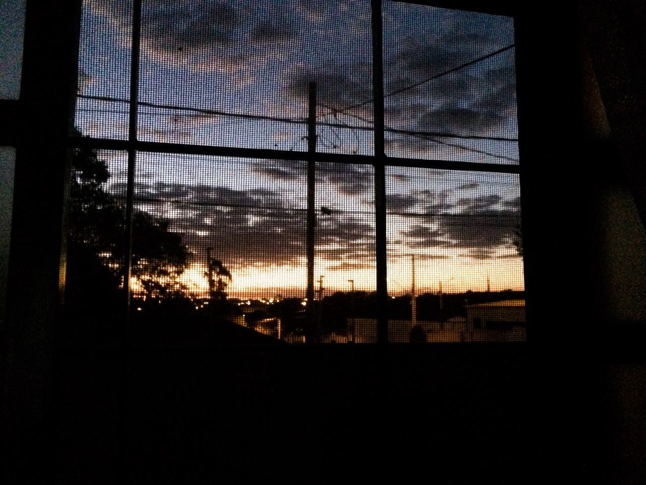 sky, window, silhouette, no people, sunset, cloud - sky, indoors, built structure, architecture, tree, nature, city, day