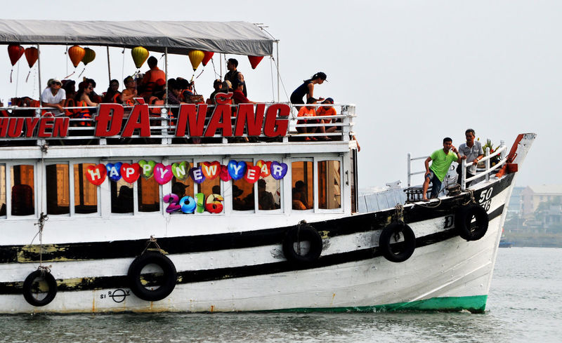 Tour boat on Han River in Da Nang, Vietnam. Attitude Boats Da Nang Day Excursions Han River Lanterns Lifejackets Lifestyle Outdoors Rivers Setting Sail Sightseeing Tourism Tourists Tyres Vietnam