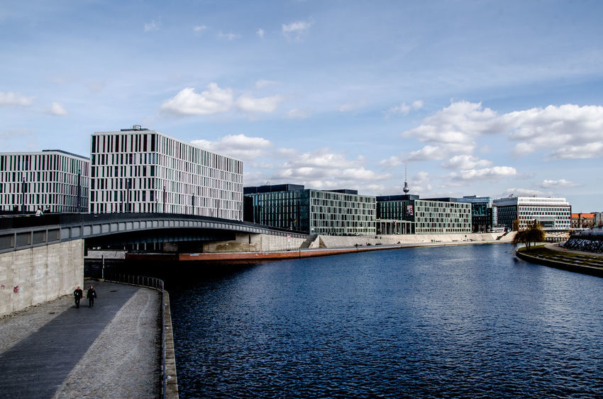 Facades along the Spree Berlin, Germany  Spree Architecture Bridge Building Building Exterior Built Structure City Cityscape Cloud - Sky Clouds Connection Day Modern Nature Nautical Vessel No People Office Building Exterior Outdoors River Sky Transportation Water Waterfront