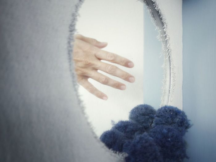Close-up of woman hand in snow