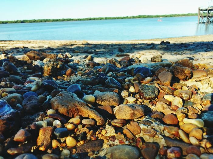 Beach Sea Pebble Beach Pebble Water Sky Shore Nature Beauty In Nature Tranquil Scene Outdoors Large Group Of Objects Horizon Over Water Surface Level Scenics Day No People Close-up