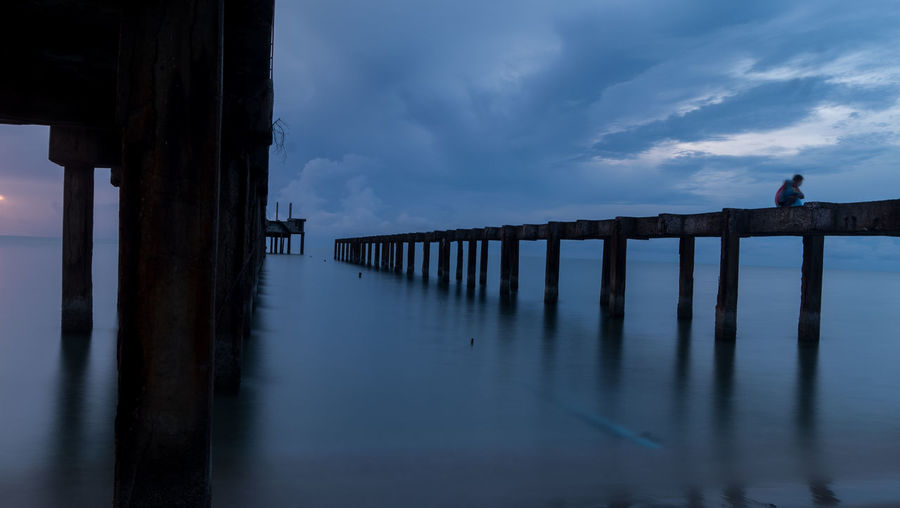 Lonely Loneliness Sky Pier Sea Architecture Built Structure Architectural Column Scenics - Nature Nature Tranquil Scene Reflection Post Beauty In Nature One Person Horizon Over Water Lonly Strain Depression - Sadness Depressive