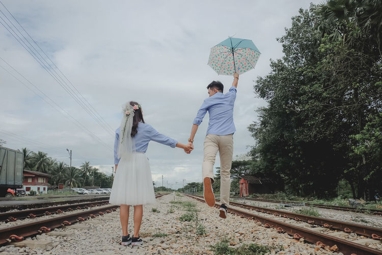 wedding Two People Real People Men Rail Transportation Railroad Track Sky Nature Plant People Love Young Men Couple - Relationship Tree Togetherness Positive Emotion Outdoors Wedding Wedding Photography