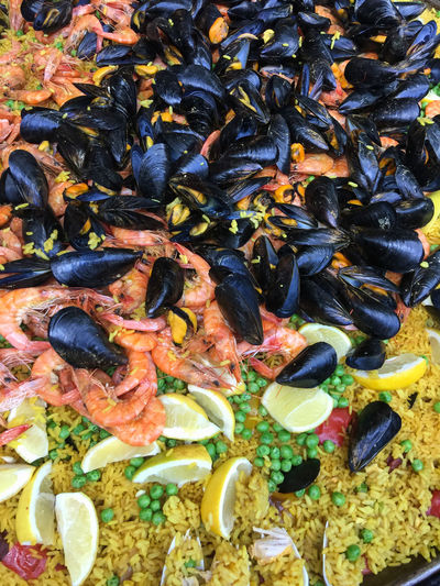 Big pan of paella, ready to serve. Paella Rice Shrimp Spanish Spanish Food Day Food High Angle View Lemon Mussel No People Peas Prawn Ready-to-eat Seafood