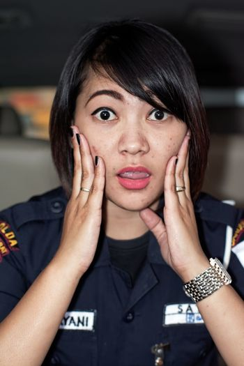 Close-up portrait of shocked security officer sitting in car