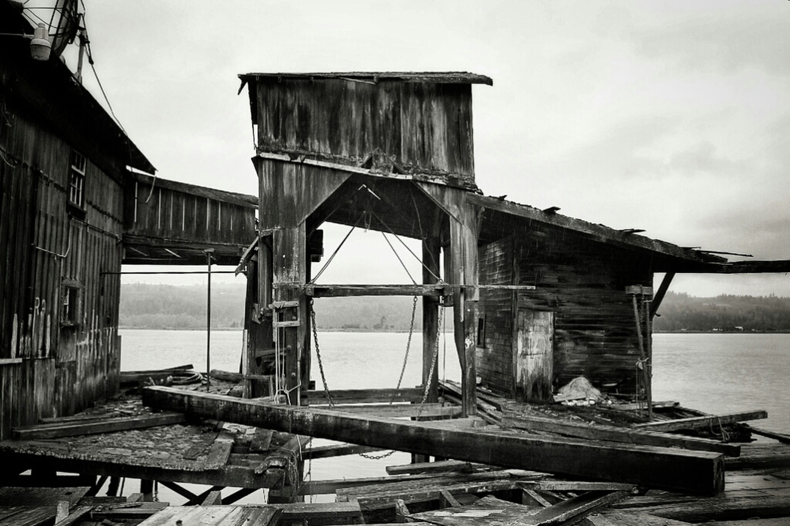 built structure, wood - material, sky, architecture, abandoned, old, water, damaged, building exterior, obsolete, wood, wooden, weathered, day, nautical vessel, pier, run-down, sea, deterioration, no people