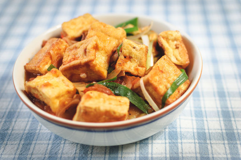 Close-up of tofu with sauce in plate