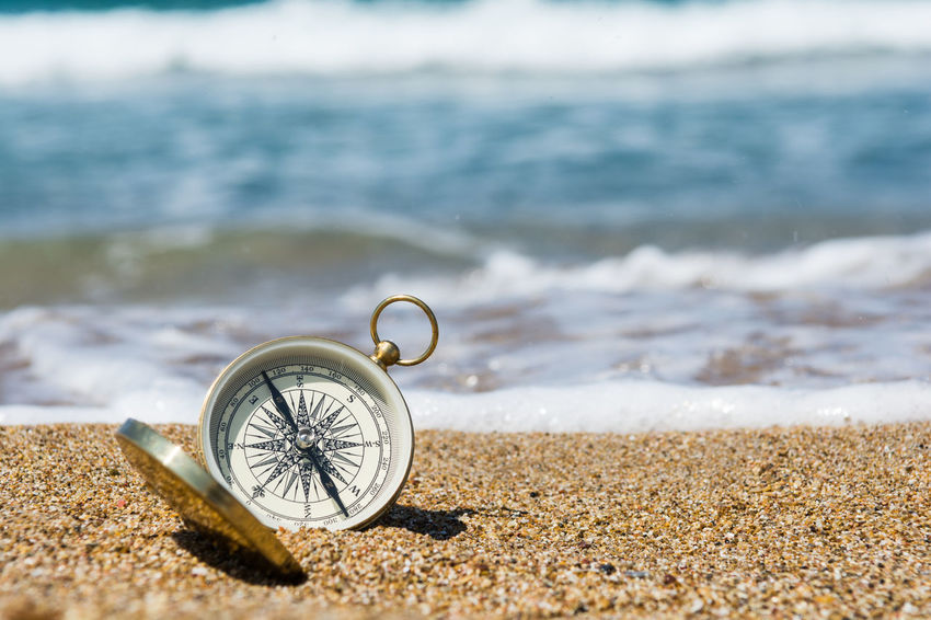 Compass on the golden sand by the sea Choice Decisions Golden Storytelling Wave Backgrounds Beach Brass Compass Concept Conceptual Dilemma Direction Discovery Exploration Guidance Inspiration Metal Outdoors Sand Sea Searching Seeking Where Which Way?