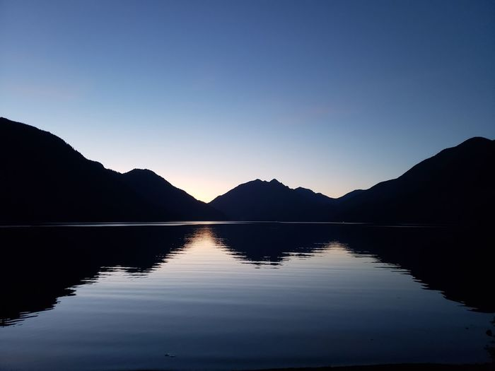 Perfect reflection of dawn over the lake. Olympic National Park Vacations Beauty In Nature Dawn Morning Beach Reflection Blue Reflection Hills Camping Water Mountain Lake Sunset Dawn Reflection Silhouette Sky Landscape Reflecting Pool Reflection Lake Symmetry Standing Water Dramatic Landscape Mountain Range View Into Land Lakeshore Calm Water Surface The Great Outdoors - 2018 EyeEm Awards Summer Road Tripping HUAWEI Photo Award: After Dark My Best Photo