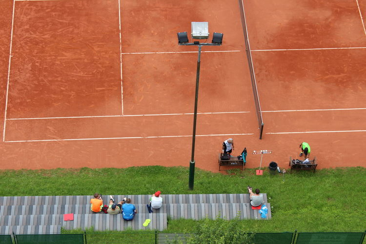 High Angle View Of People At Tennis Court