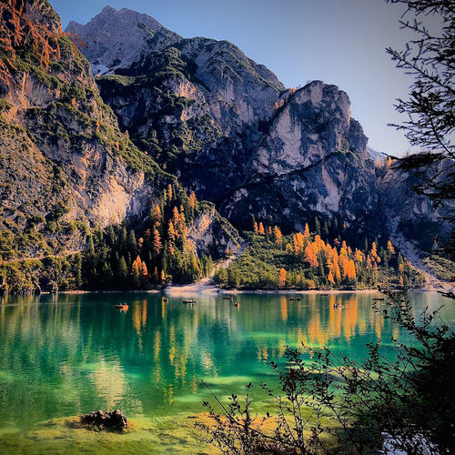 Scenic view of lake by mountain against sky