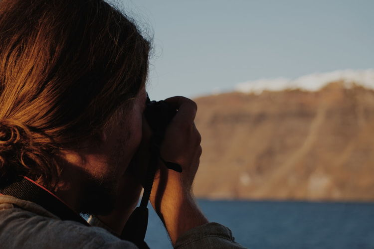 Close-up woman photographing outdoors