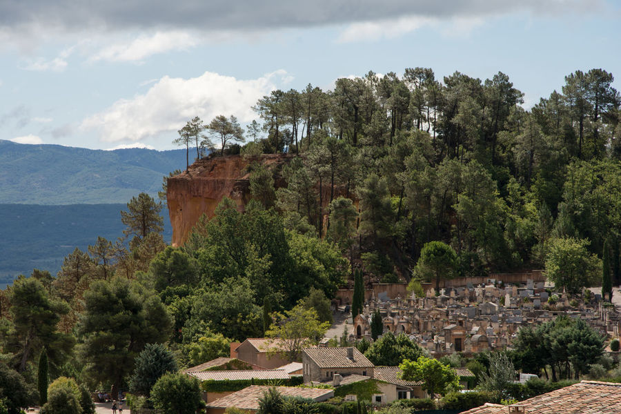 graveyard of roussillon Cemetery France Houses Provence Sky And Clouds Architecture Building Exterior Built Structure Day Digs Forest Graveyard History Landscape Mountain Mountains Nature No People Outdoors Roofs Roussillon Sky Town Tree