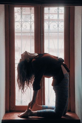 Take you away Window Indoors  One Person Day Lifestyles Adult Nature Full Length Women Bending Young Women Motion Side View Sunlight Hairstyle Contemplation Emotion