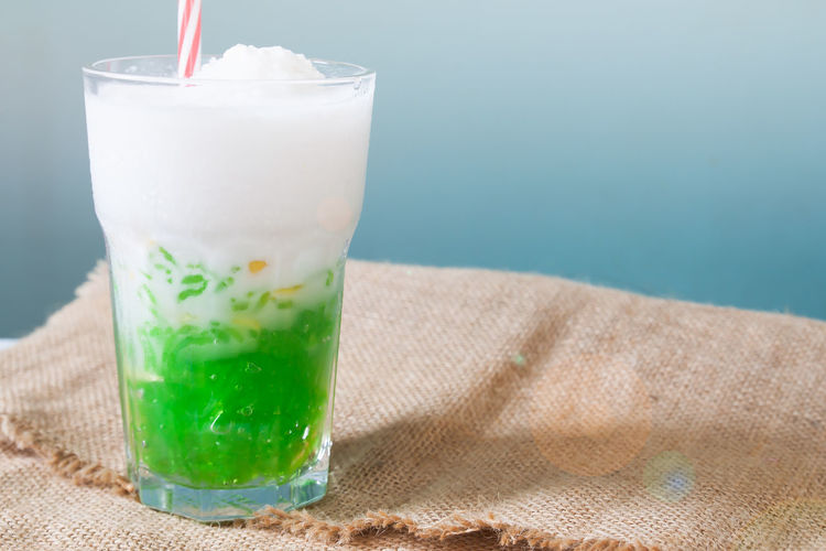 Close-up of ice cream and drink in glass on table