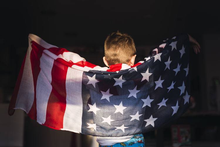 Rear view of man standing in flag