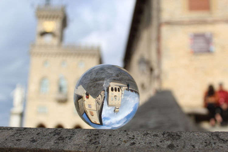 Close-up of crystal ball on retaining wall in city