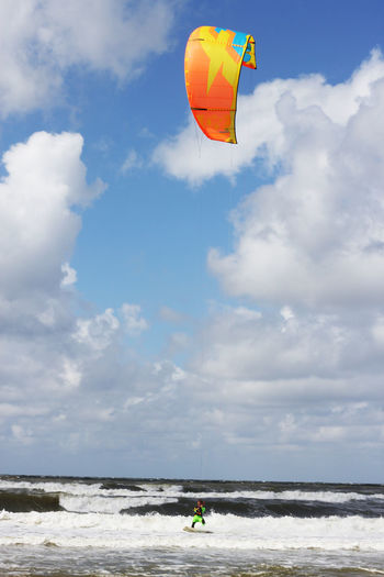 Adventure Beauty In Nature Cloud - Sky Day Extreme Sports Kitesurfing Kitesurfing Freestyle Leisure Activity Lifestyles Men Motion Nature One Person Outdoors People Real People Sea Skill  Sky Sport Water