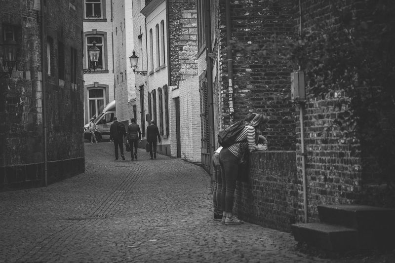 Street Photography Maastricht Black & White Maastricht Holland Adult Alley Architecture Brick Building Building Exterior Built Structure City Day Direction Footpath Full Length Group Of People Lifestyles Men Outdoors People Real People Street The Way Forward Walking Wall Women The Street Photographer - 2018 EyeEm Awards