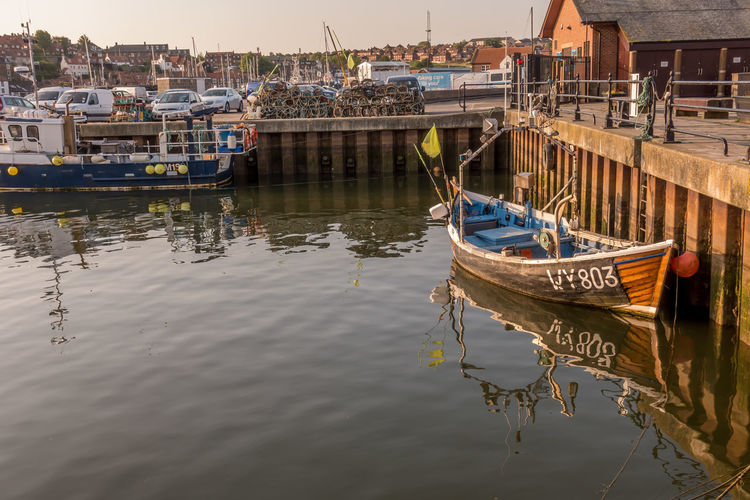 Whitby Whitby Harbour Whitby View Whitby North Yorkshire North Yorkshire Fishing Boat Harbour Harbour View Nautical Vessel Marina Fishing Boats Fishing Industry Port Anchored Pier Outdoors No People Waterfront Water Mode Of Transportation Transportation Moored Reflection Harbor Sailboat