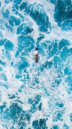 Chaotic Beauty Surf Waves People One Person Real People High Angle View Day Men Lifestyles Water Leisure Activity Sport Adventure Beauty In Nature Sea Motion Outdoors Blue Nature Full Length Trip