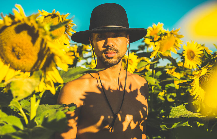 the man in the sunflower field. Agriculture Beauty In Nature Blooming Flower Flower Head Fragility Freshness Growth Human Representation Nature Outdoors Petal Plant Sunflower Vibrant Color Yellow Young Adult
