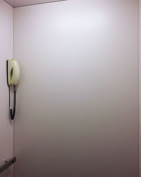 Landline phone wall at home