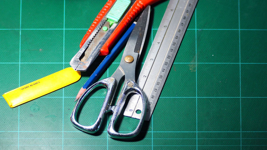 Scissor and cutter and ruler and pencil and blades on the green cutting mat and top view angle camera. Work Tool Equipment No People Indoors  Hand Tool Tool Green Color Scissors Choice High Angle View Education Ruler Instrument Of Measurement Directly Above Group Of Objects Close-up Still Life Tile Flooring Scissor And Cutter And Ruler And Pencil And Blades On The Green Cutting Mat And Top View Angle Camera. Mat; Cutting; Scissors; Cutter; Ruler; Background; Green; Paper; White; Craft; Office; Cut; Equipment; Grid; School; Scale; Tools; Design; Measure; Pencil; Board; Stationery; Supplies; Blades; Tape; Education; Tool; Sheet; Measurement; Instruments; Glue;