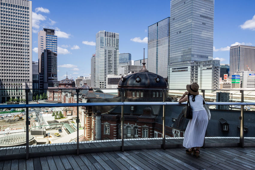 今、彼女は何を想ふ Building Buildings City City Life Cityscape Cityscapes Lady Olympus Olympus Om-d E-m10 Skyline Station Terrace Train Station