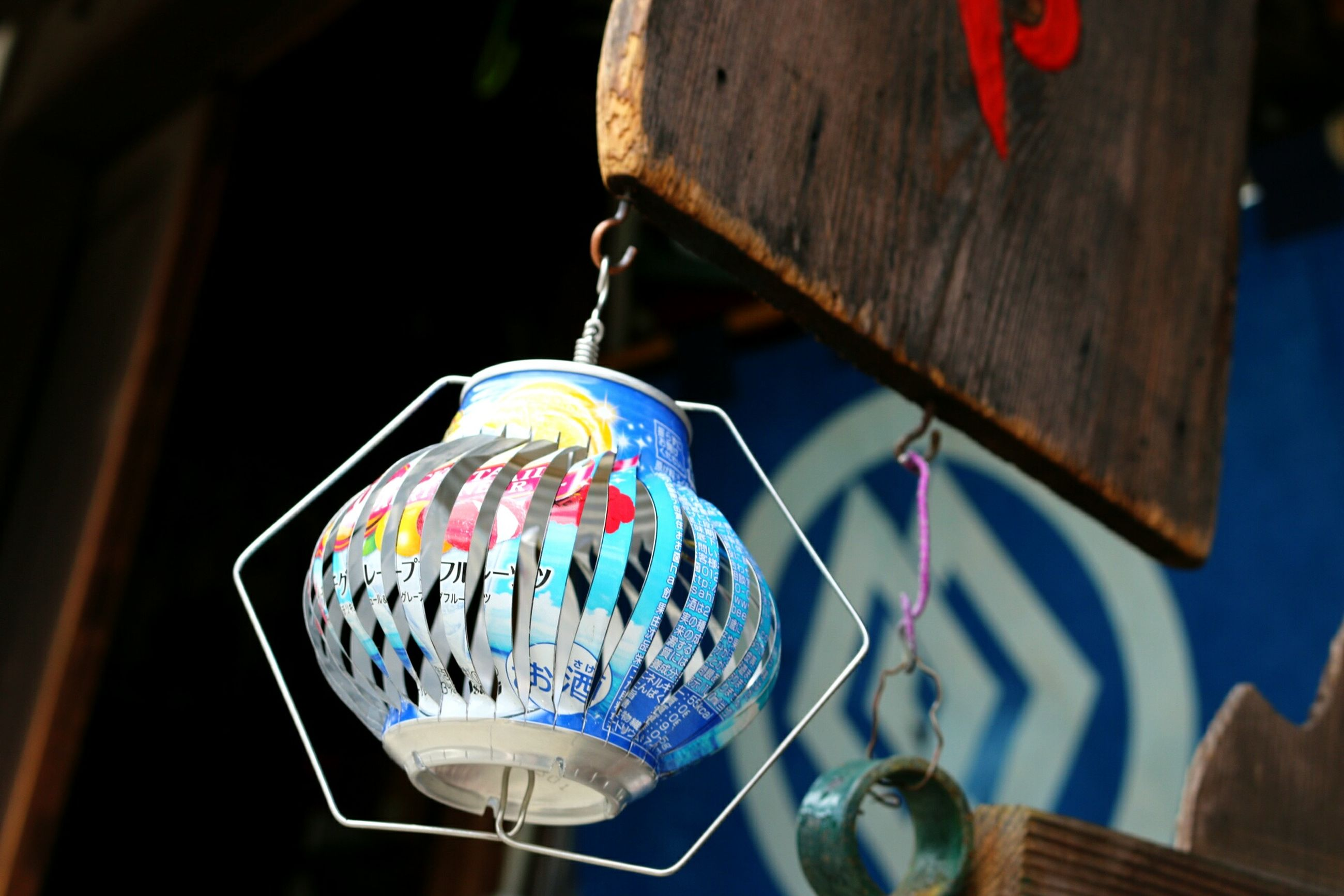 indoors, hanging, multi colored, still life, decoration, close-up, focus on foreground, table, lantern, wood - material, no people, blue, illuminated, colorful, low angle view, celebration, lighting equipment, selective focus, art and craft, home interior