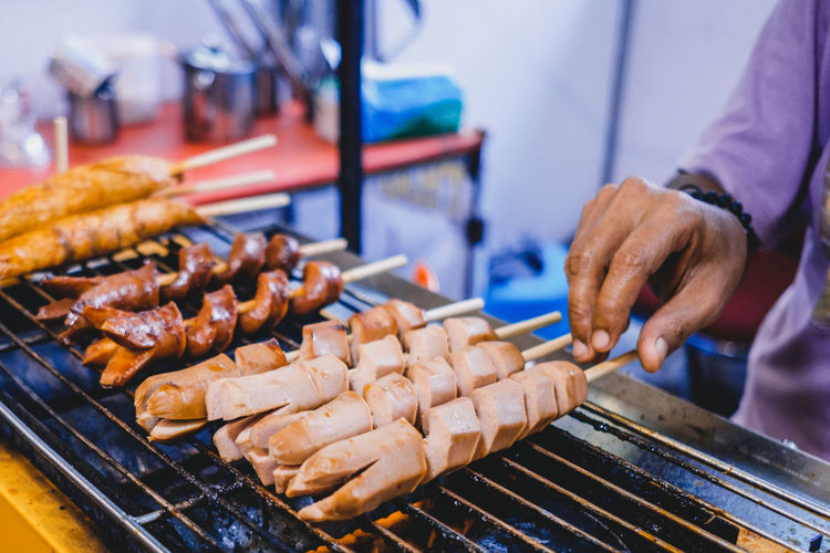 Food Food And Drink Freshness Indonesian Jajanan Jajan Pasar Barbecue Meat Preparation  Barbecue Grill Grilled Human Hand One Person Hand Skewer Sausage Focus On Foreground Preparing Food Human Body Part Midsection Heat - Temperature Close-up Meal Snack Outdoors