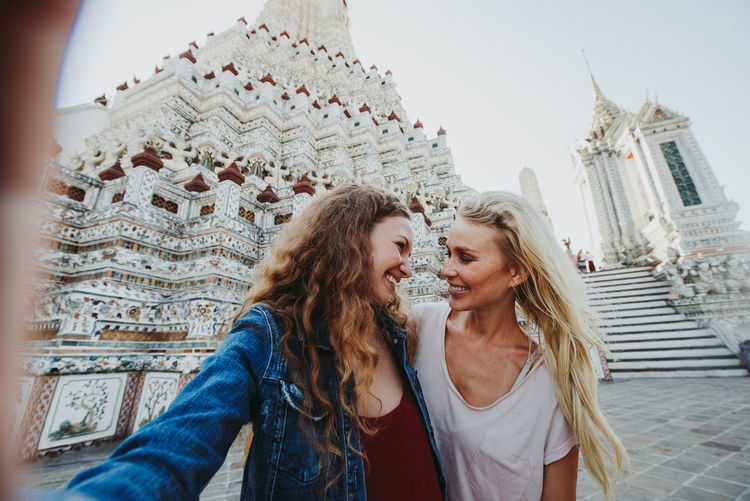 Happy women at temple in city