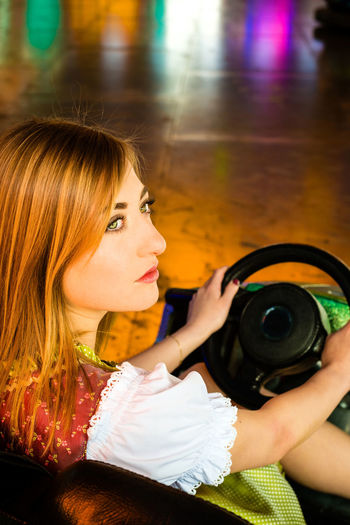 High angle view of young woman sitting in bumper car