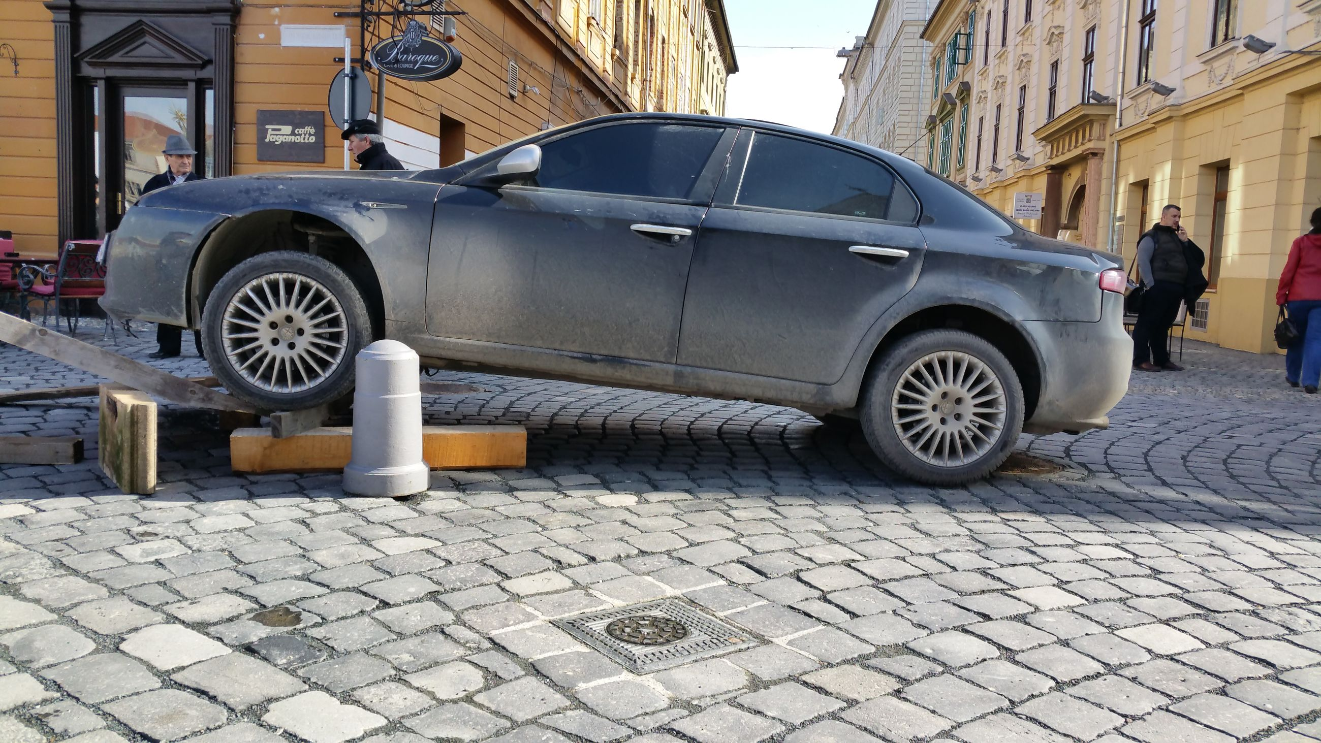 cobblestone, tire, car, outdoors, day, adult, people