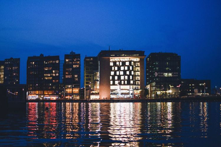Amsterdam Building Exterior Architecture Built Structure Water Waterfront City Night Illuminated Sky Reflection Building Nature Blue No People Dusk Urban Skyline Cityscape River Office Building Exterior Outdoors Modern Skyscraper Apartment EyeEm Best Shots