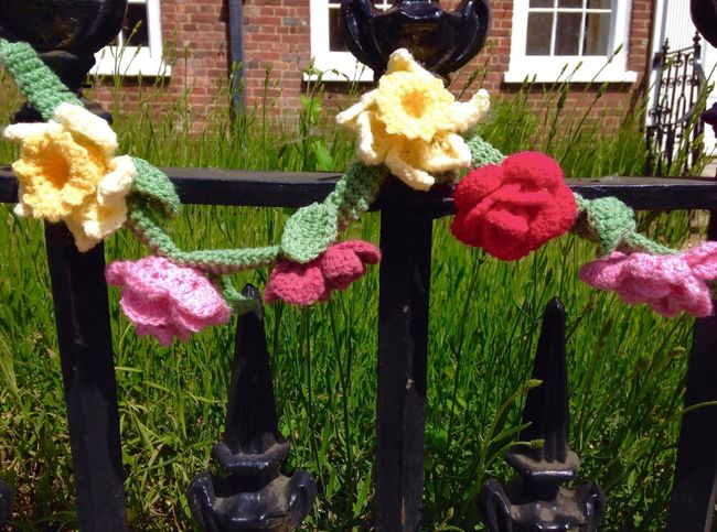 Flower Outdoors No People Growth Building Exterior Day Architecture Nature Built Structure Plant Close-up Beauty In Nature Freshness knitted Flower Head Grass Fragility flowers on the railings