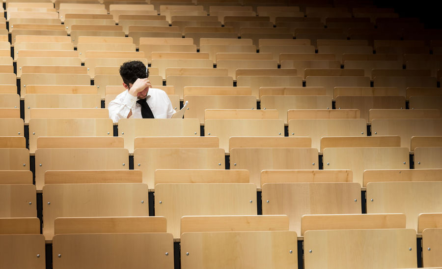 auditorium at a university Learning Student Auditorium Day Desk Education In A Row Indoors  Learning Lecture Hall Men One Person People Performance Real People Sitting Student University University Student Young Adult Young Men