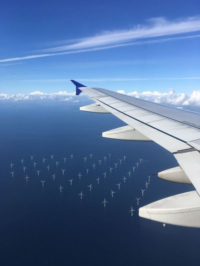 Windmill-powered plant in the Öresund close to Copenhagen, seen from plane. Pattern Mid-air Water Travel Aircraft Wing Cloud - Sky Flying Mode Of Transportation Sky Transportation Air Vehicle Airplane Wind Energy Climate Change øresund Renewable Energy Environmental Issues Carbon Footprint Copenhagen Motion White And Blue Opposites Antipodes Contrast Extremes