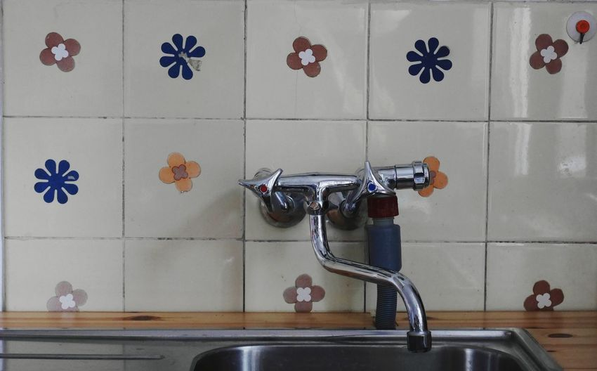 Close-up of faucet in bathroom at home